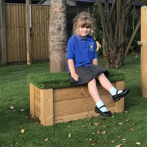 Large Moveable Artificial Grass-Topped Seat