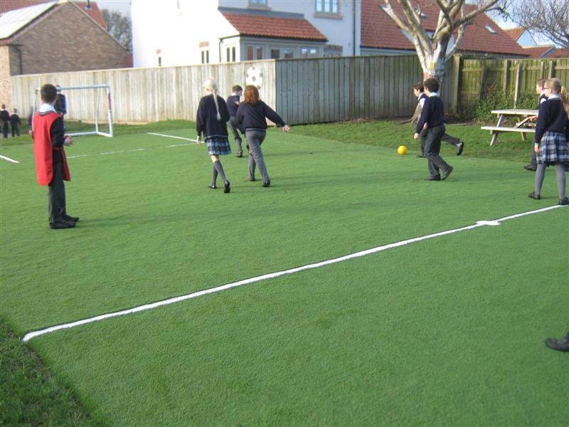 Children enjoy football on Wolviston's Multi Use Games Area
