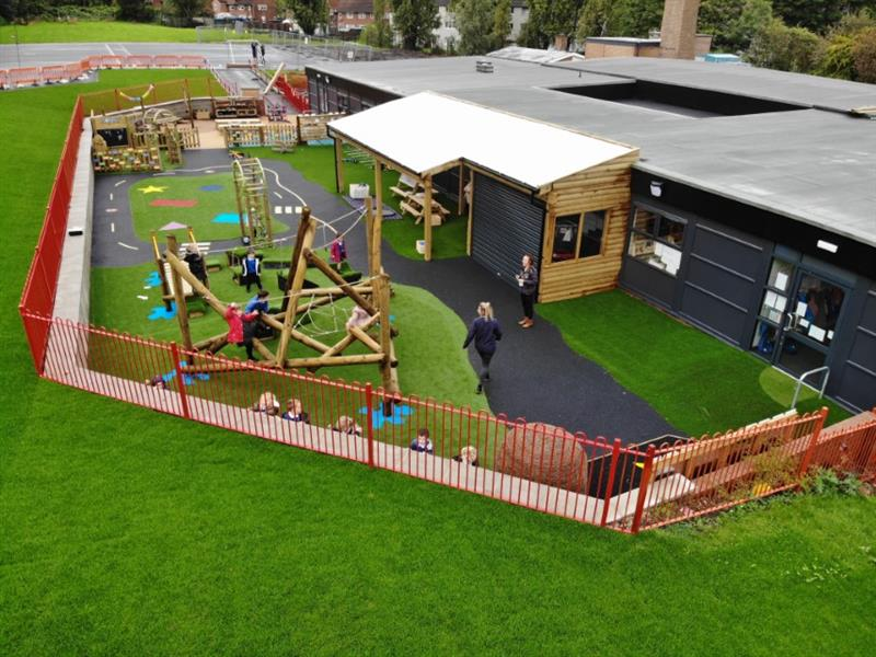 An eyfs playground development created for ryecroft primary academy in leeds featuring a climbing frame, colourful playground surfacing and a huge timber canopy