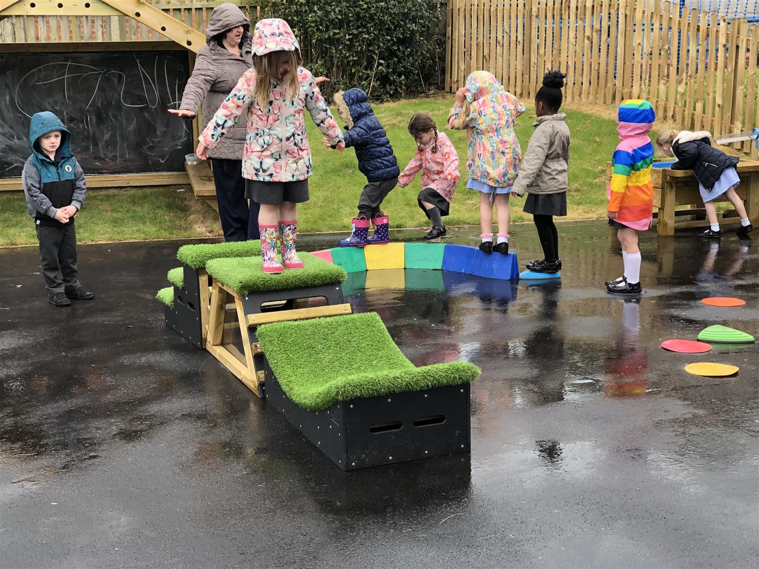 Children stepping, balancing and climbing over get set go blocks