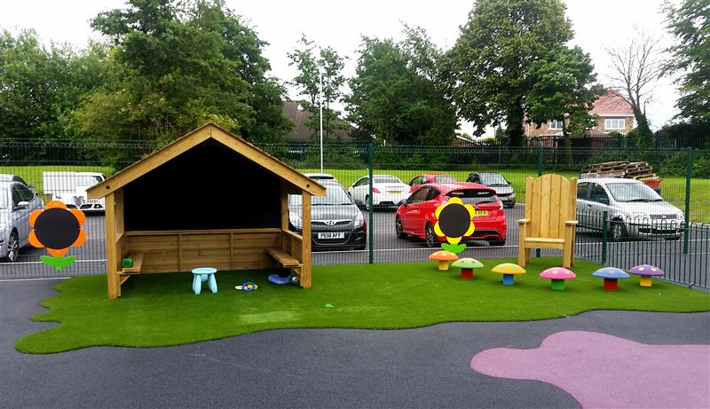 Playhouse and Story telling circle installed at a school with special education needs