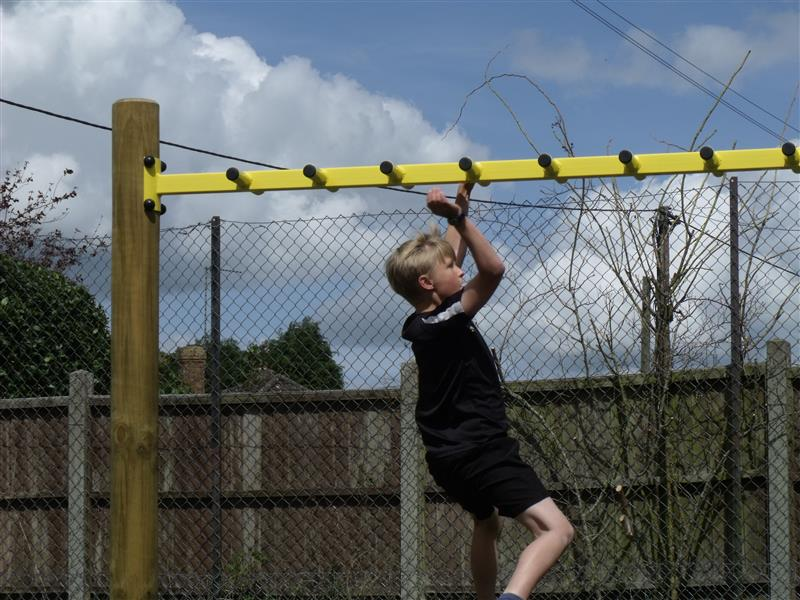 Monkey bars are a great outdoor activity for young children and can be found in playgrounds
