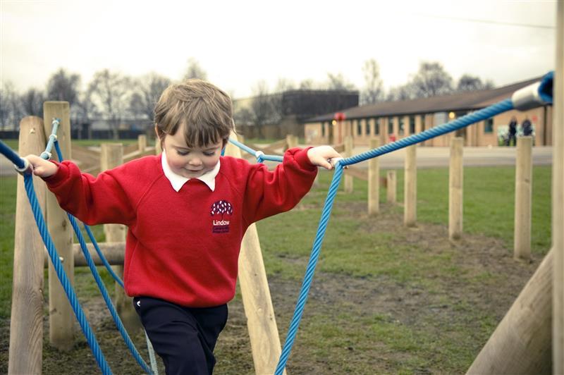 Inclusive outdoor balance beams for deaf children
