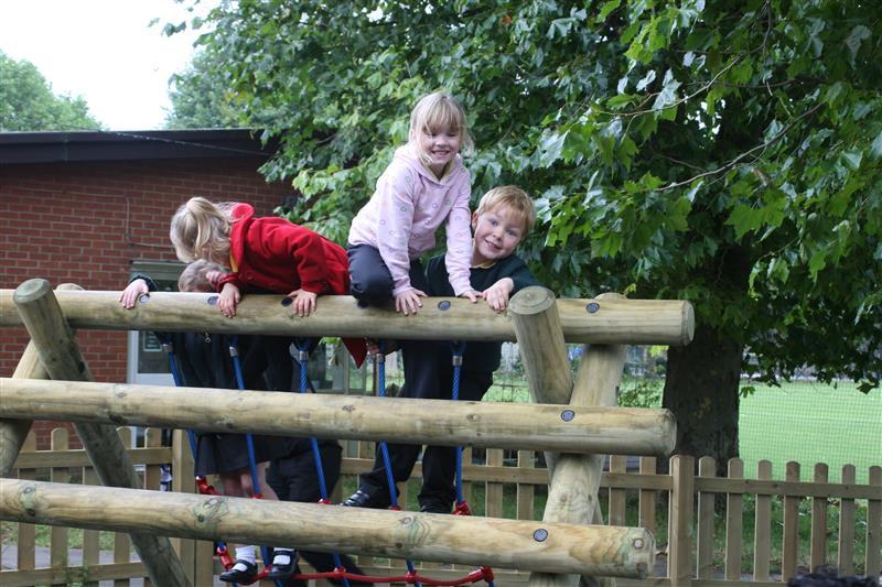 Children outdoors climbing